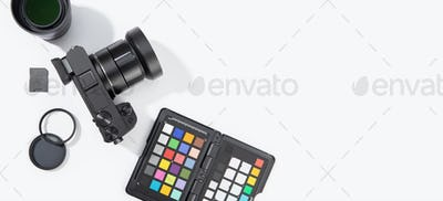 Banner of digital photographic equipment on white table with copy space