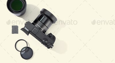 Flat lay of digital photographic equipment isolated on beige background
