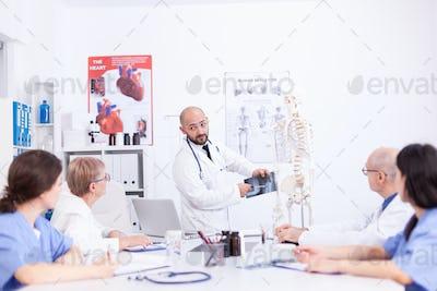 Surgeon holding radiography