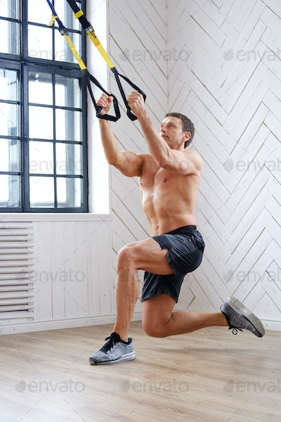 A man doing workouts in the training room.