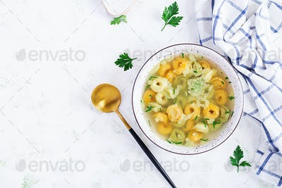 Tortellini in broth, italian traditional dish. Italian pasta. Top view, flat lay, overhead
