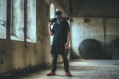 Gangsta skater in mask with skateboard.