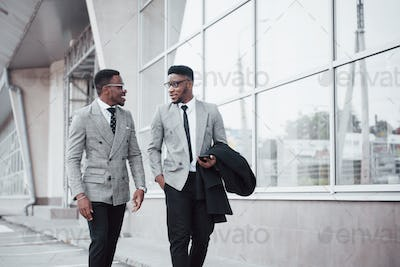Business communication. Two cheerful business men talking to each other and discussing a project