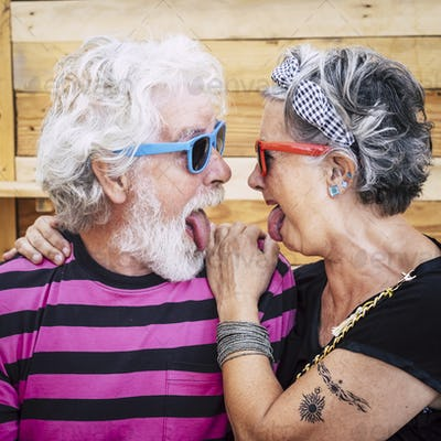 Portrait of cheerful caucasian senior crazy couple