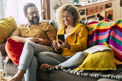 Happy and cheerful adult couple enjoy time at home