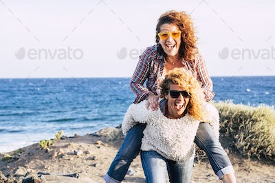 Happy and cheerful middle age couple of caucasian women enjoy