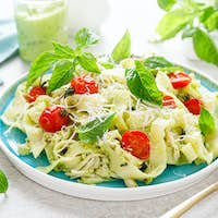 Pasta fettuccine with chicken breast, baked tomatoes, parmesan cheese and avocado guacamole sauce