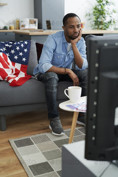 Bored man in front of TV