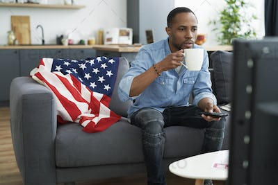 Black man affectionate in watching TV