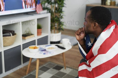 High angle view of man waiting for USA election results