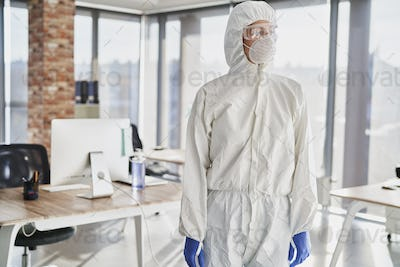 Person in uniform before working during pandemic outbreak