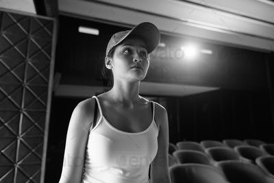 Young beautiful Asian tourist woman inside theater