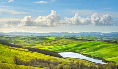 Tuscany, small lake and rural landscape on sunset, Siena Italy.