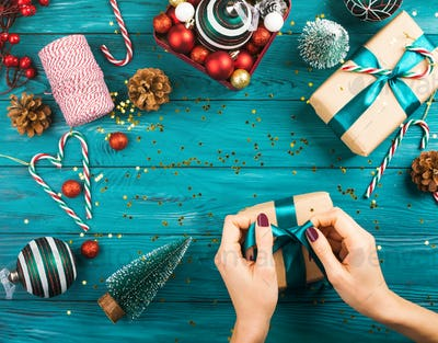 Female hands wrapping presents for Christmas