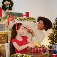 Girls wrapping gifts