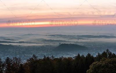 Graz city covered if fog on autumn morning during sunraise