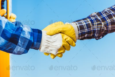 Cropped shot of two man in protective gloves shaking hands