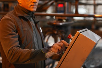 Worker Operating Machines at Factory Close Up