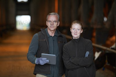 Portrait of Two Workers at Farm