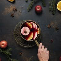 Winter mulled wine with orange, apple, cinnamon and anise star,