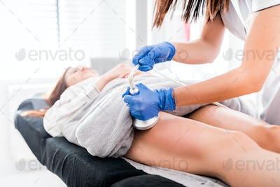 Anti-cellulite treatment at medical spa center, vacuum massage procedure