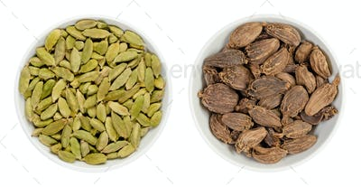 Green and black cardamom pods in white bowls, isolated on white background