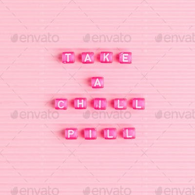 TAKE A CHILL PILL beads text typography