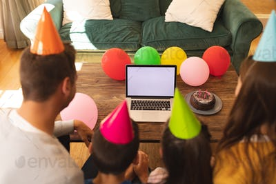 Caucasian family spending time at home together celebrating birthday