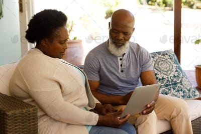 Senior african american couple spending time at home together