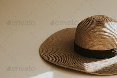 Wide brim straw hat on beige