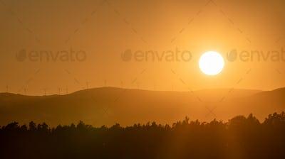 Dramatic silhouette sunset over Lavanttaler Alps in Styria