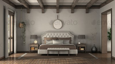 Double bed in front of a wall with hexagonal tiles