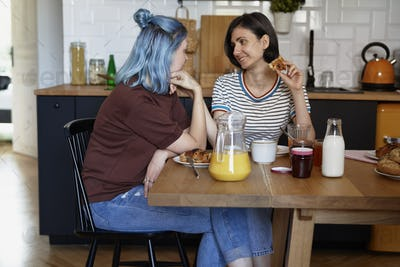 Two woman staring at each other while breakfast
