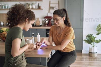Happy women making nail beauty treatments