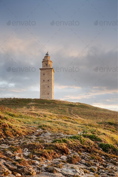 View of Tower of Hercules ancient roman lighthouse at sunset.