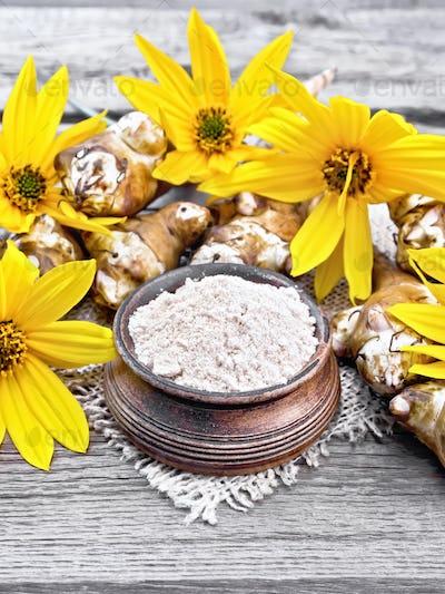 Flour of Jerusalem artichoke in bowl on napkin