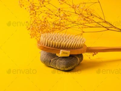 Zero waste dry massage wooden brush on yellow