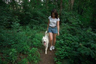 Beautiful woman walking her dog