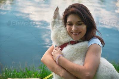 Smiling woman hugging her dog