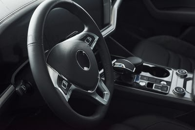 Interior of a prestigious modern black car. Leather comfortable seats and accessories and steering