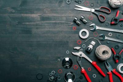 Plumbing tool set on working desk, top view