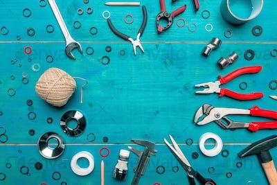 Plumbing toolkit on work desk top view flat lay