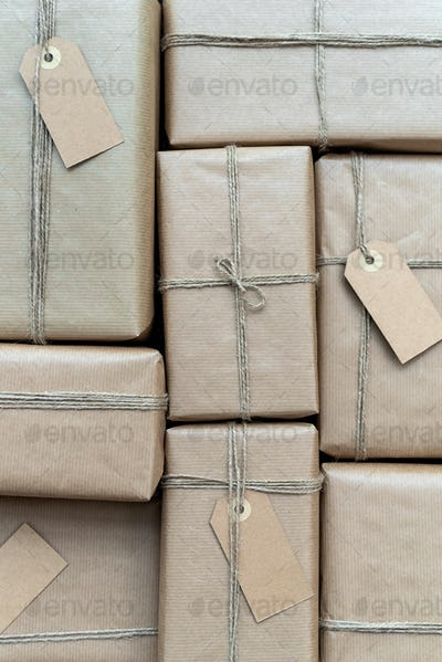 A lot of gifts wrapped in recycled paper