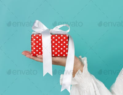 Hand holding wrapped gift box
