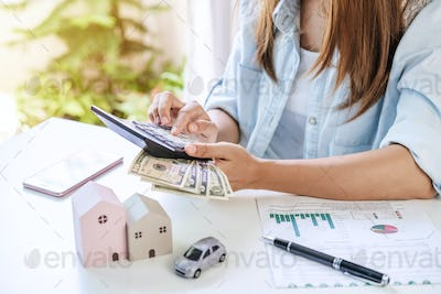 Stressed young woman calculating monthly home expenses and Car installment