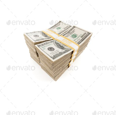 Stacks of One Hundred Dollar Bills Isolated on a White Background