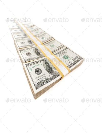 Row of Stacks of Hundred Dollar Bills Isolated on a White Background