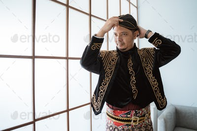 A portrait of a costume traditional Javanese man