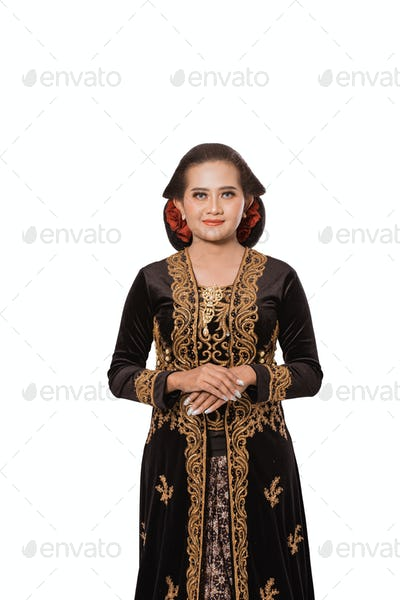 A portrait of a costume traditional Javanese woman