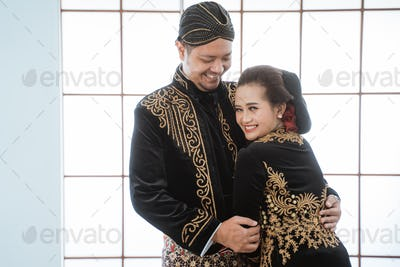 Portrait happy men and women wearing javanese traditional clothes